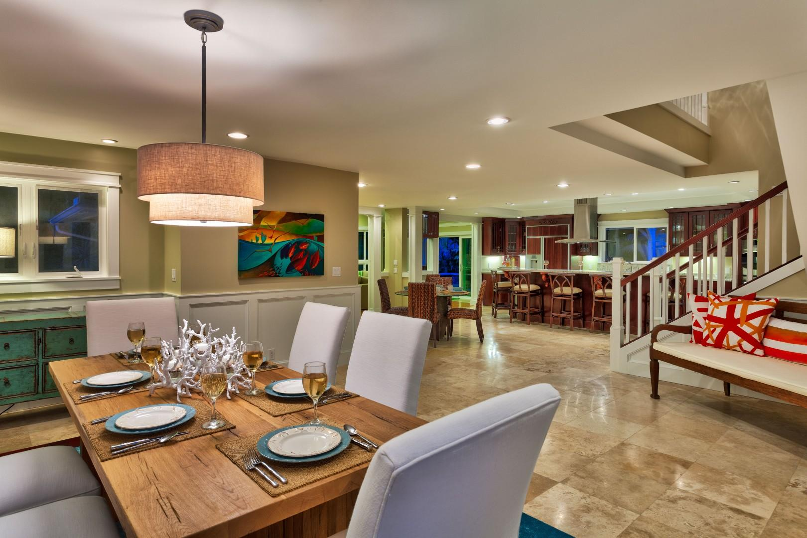 The spacious and elegant dining room, with a view of the kitchen.