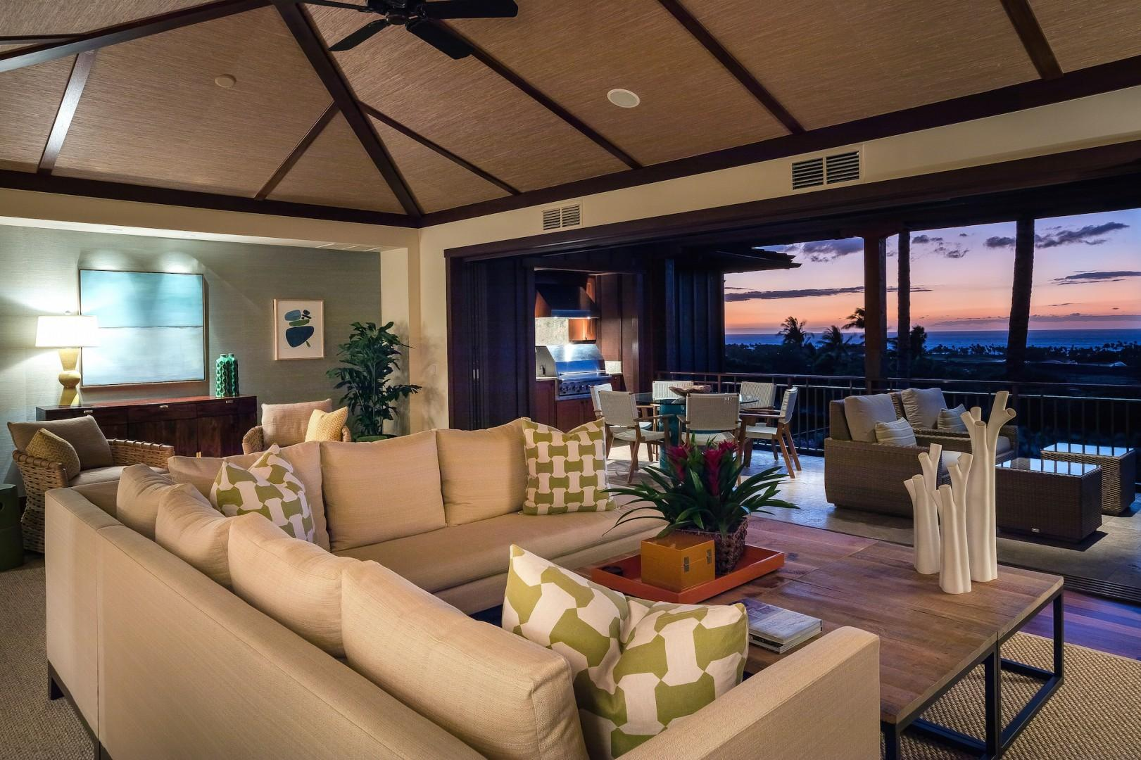 Enjoy colorful tropical sunsets in comfort with seamless transition between indoor and outdoor living spaces.