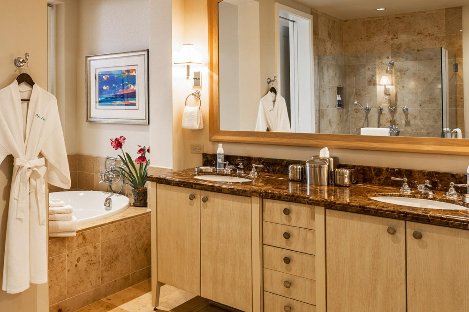 En suite master bath with large soaking tub, separate glass shower, dual vanities, private water closet, spacious walk-in closet, and safe.