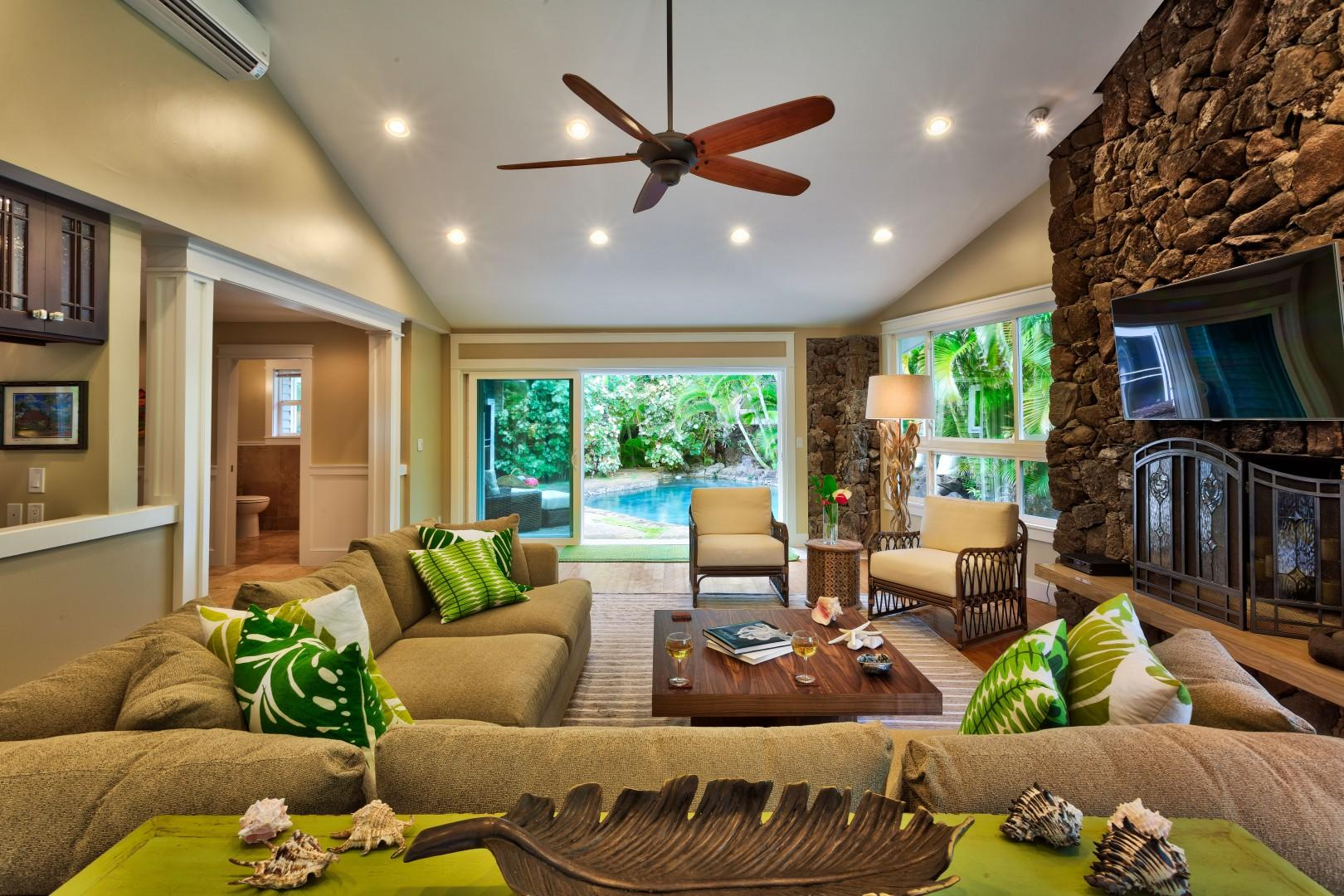Cozy up in the living area, which is between the pool, kitchen and barbecue areas - central to all of the action!