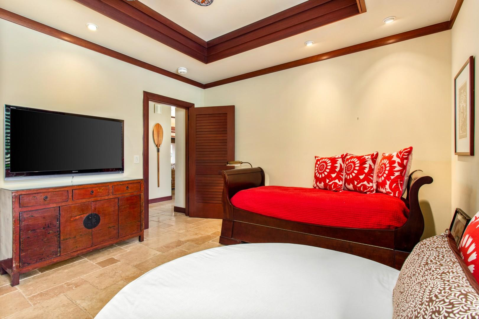 Alternate view of bedroom suite #3 showcasing wall mounted flat-screen cable television.
