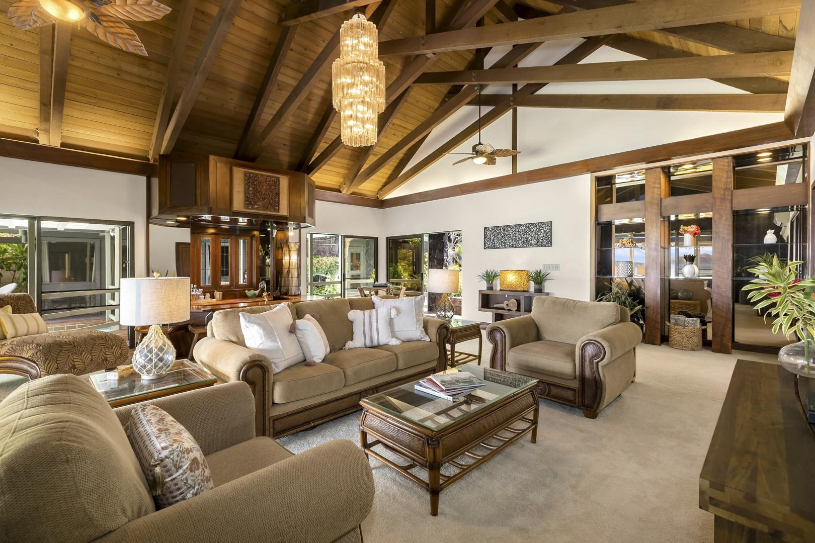 Living Room features vaulted ceilings, a/c and custom bar