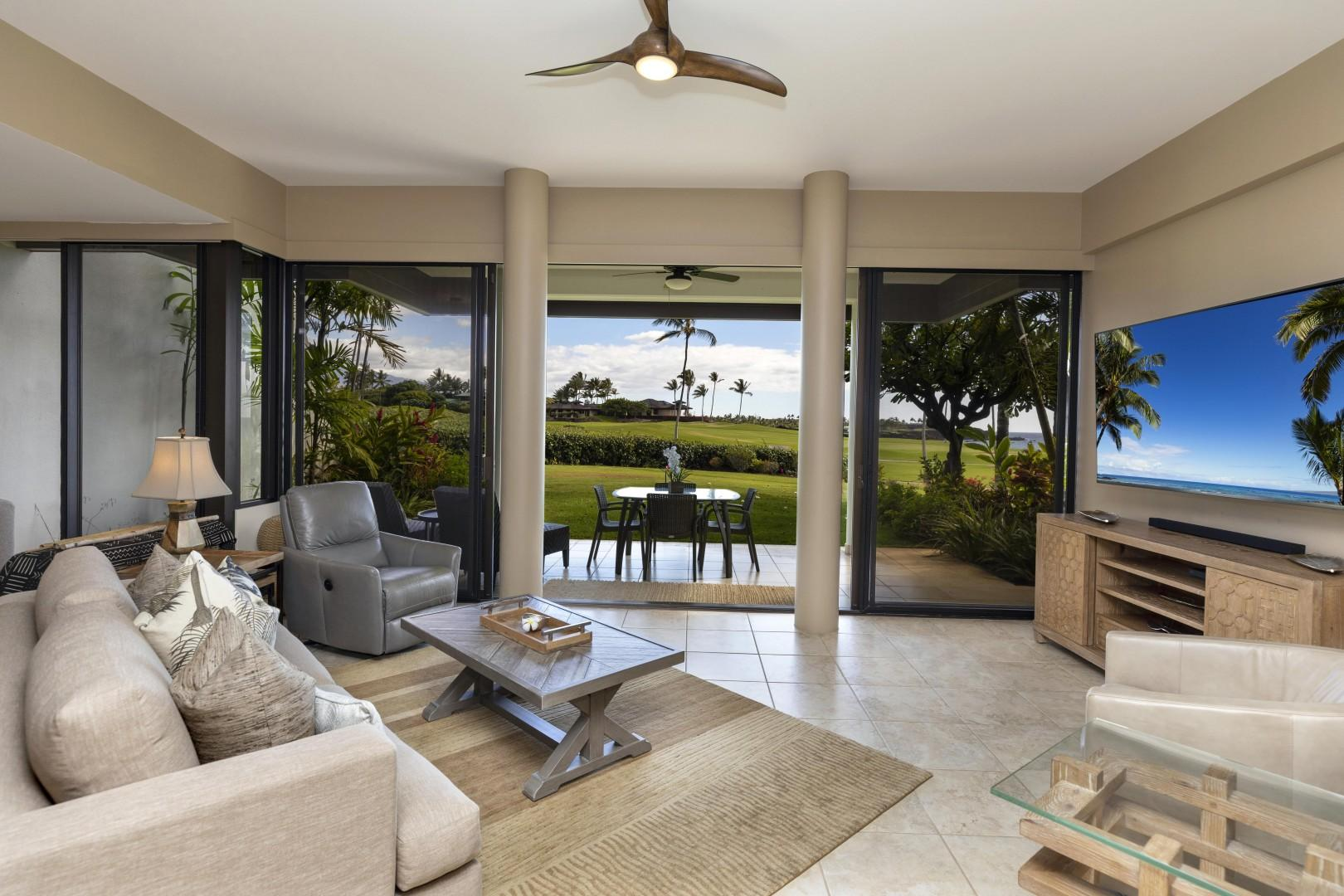 Easy access to the lanai and beautiful views from the living room.