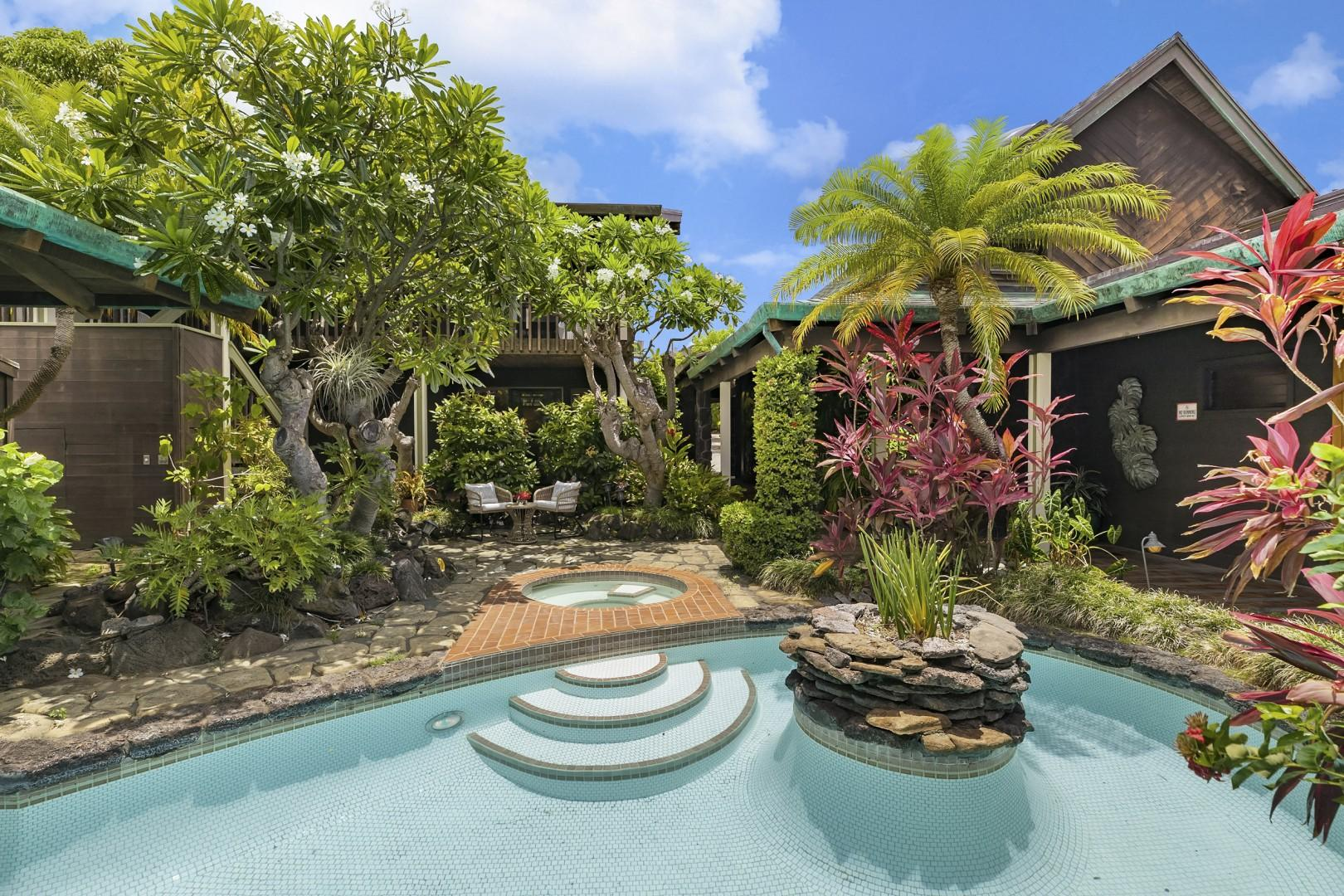 Home is centered around a large courtyard with lush tropical landscaping and resort-style pool and jacuzzi.
