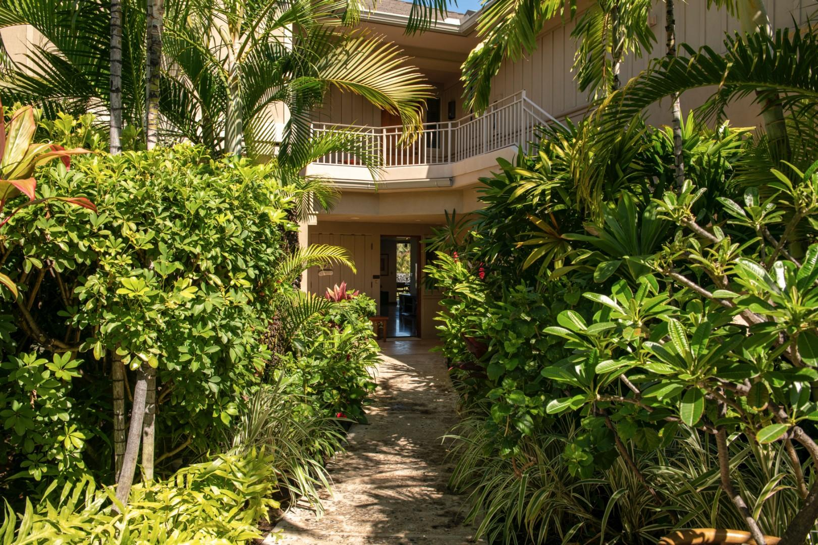 Private tropically landscaped entrance path to villa.