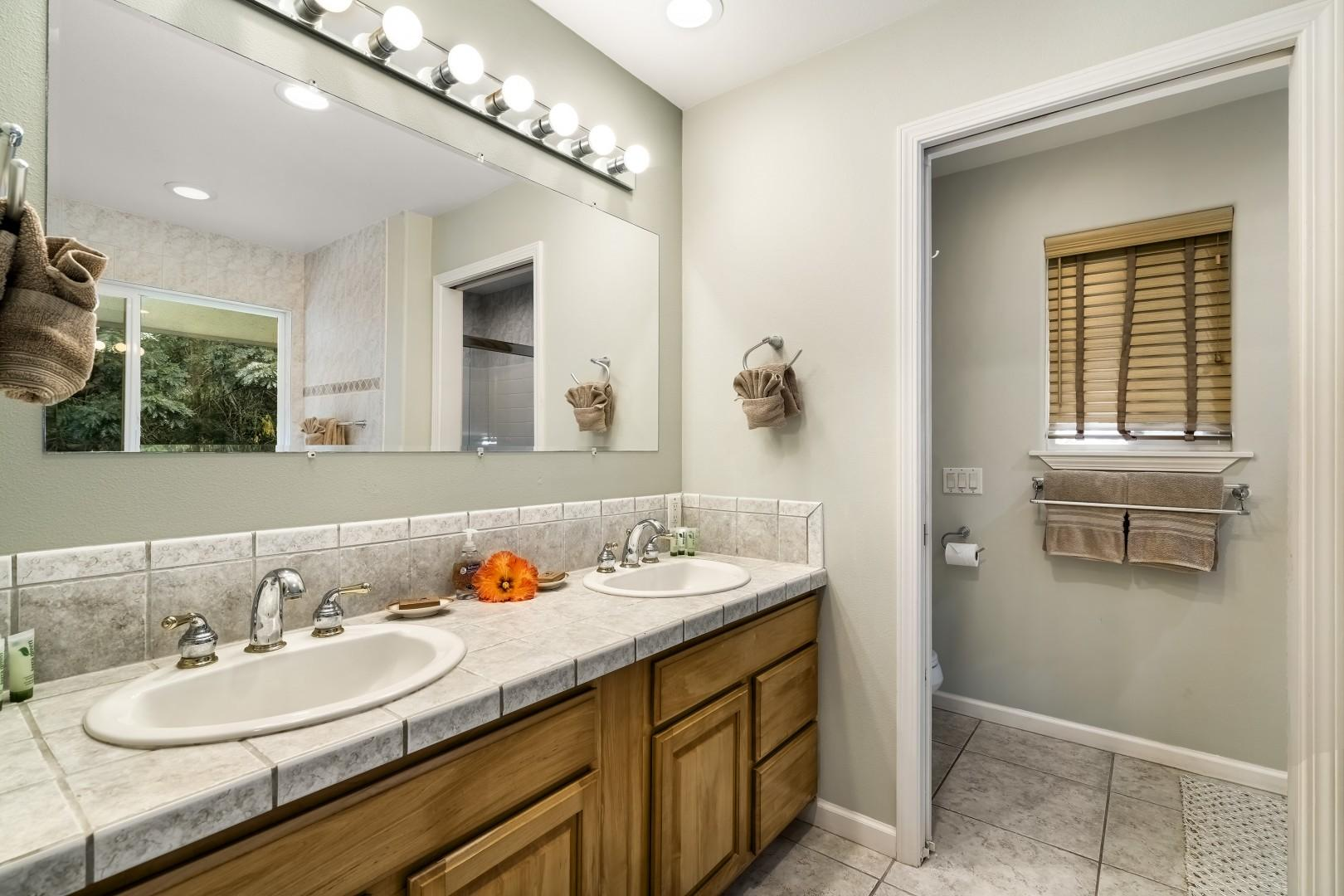 Spacious master bathroom with dual vanities