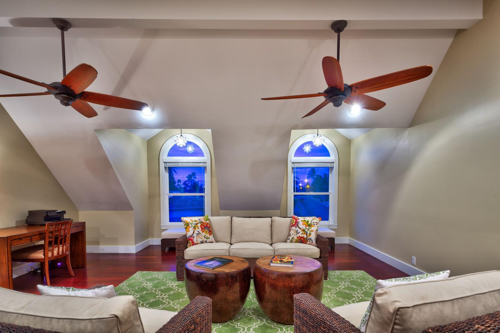 Enjoy your privacy in the master bedroom seating area, with a desk, sitting area with an air conditioner.