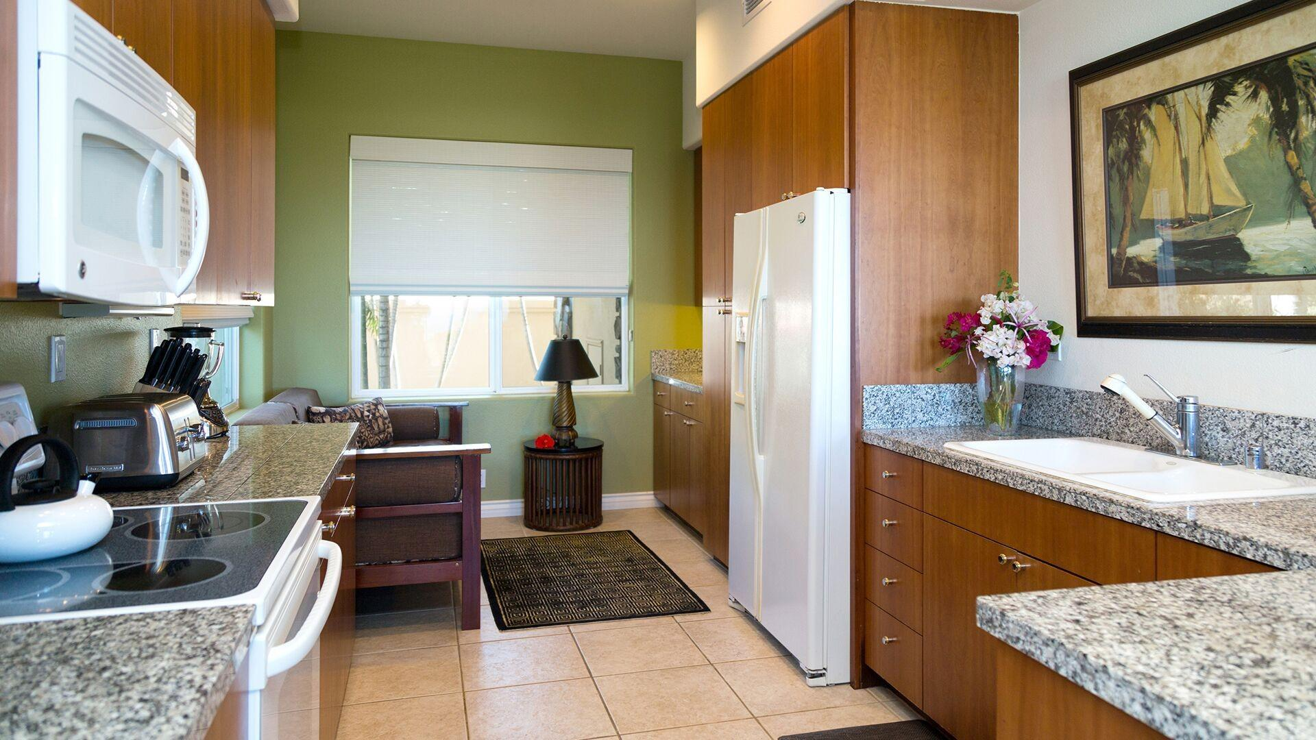 The modern kitchen has all the appliances you need and a day bed to relax while in-between preparing meals.