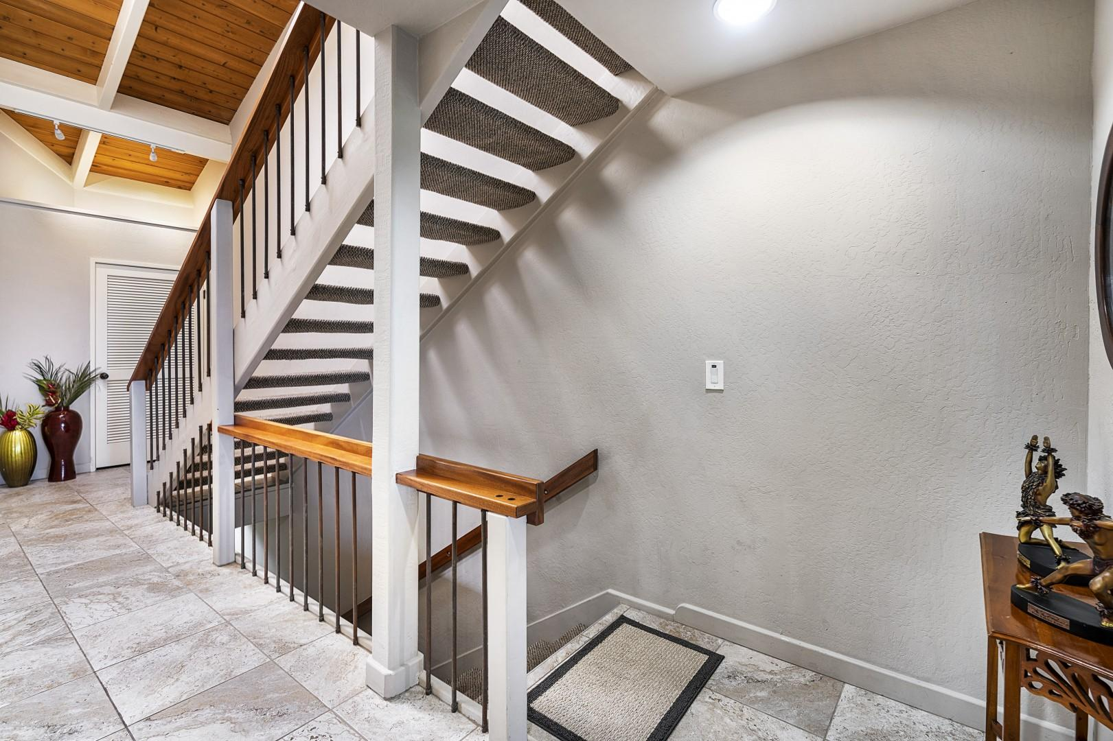Stairs leading from the entry up to the Master bedroom loft