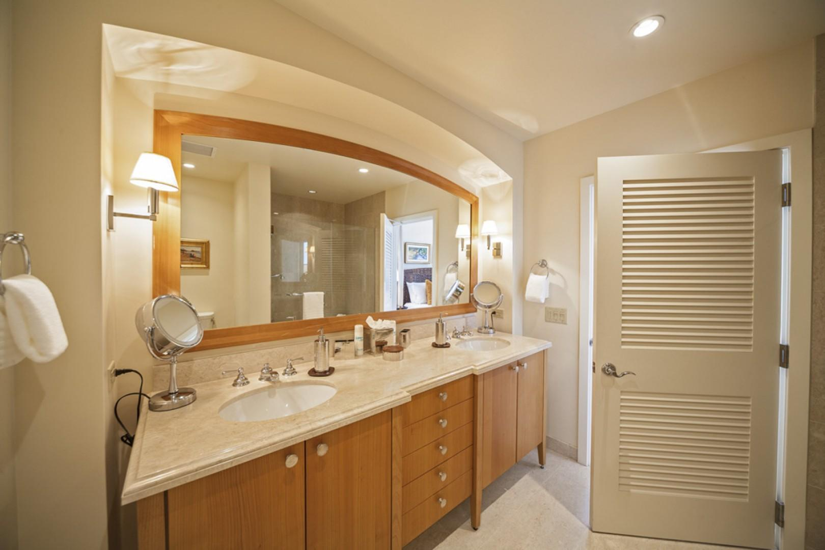 Second master bedroom en suite bath with glass shower, dual vanities, and two closets.