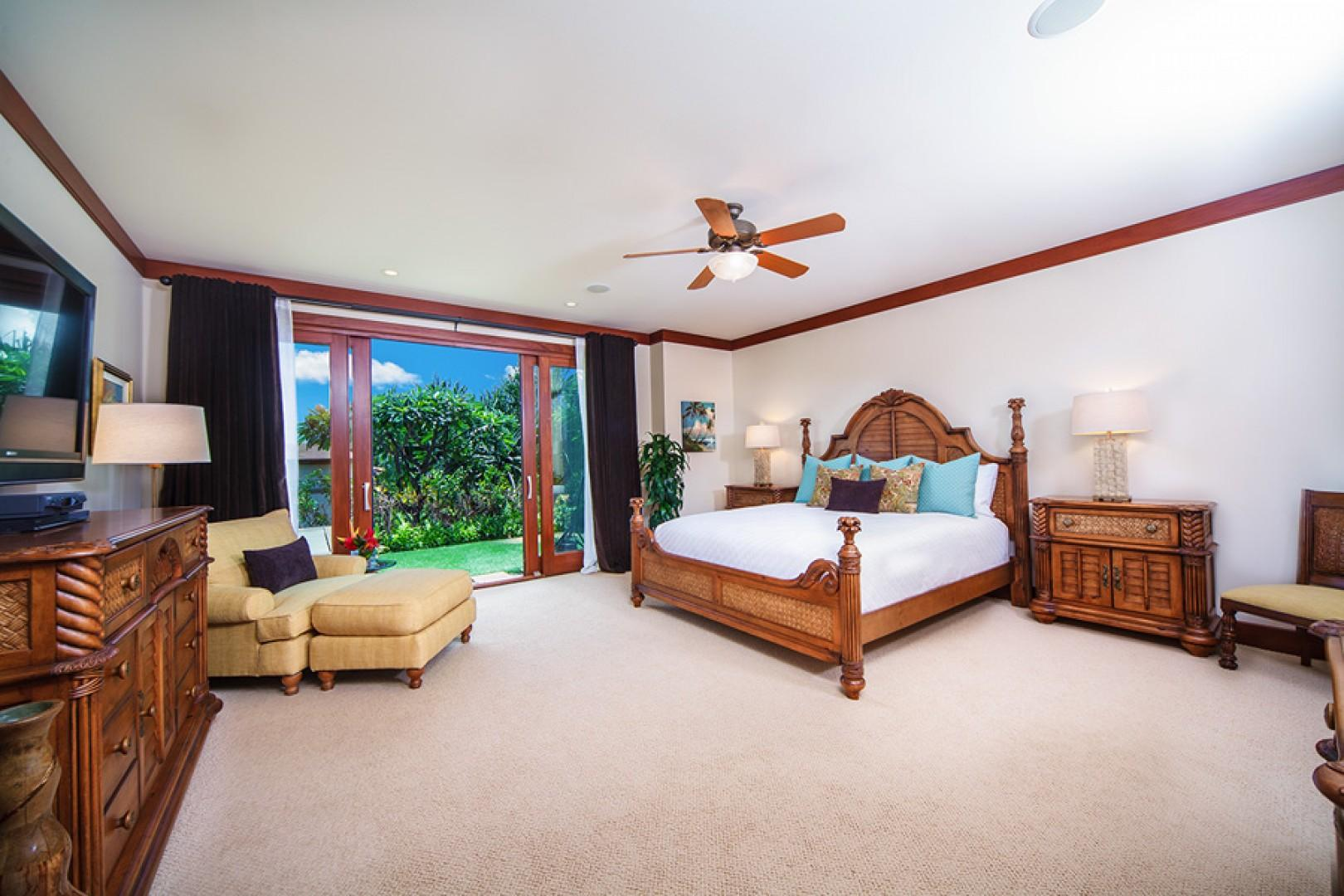 Master bedroom with king bed, en suite bath, and direct access to the plunge pool and garden.