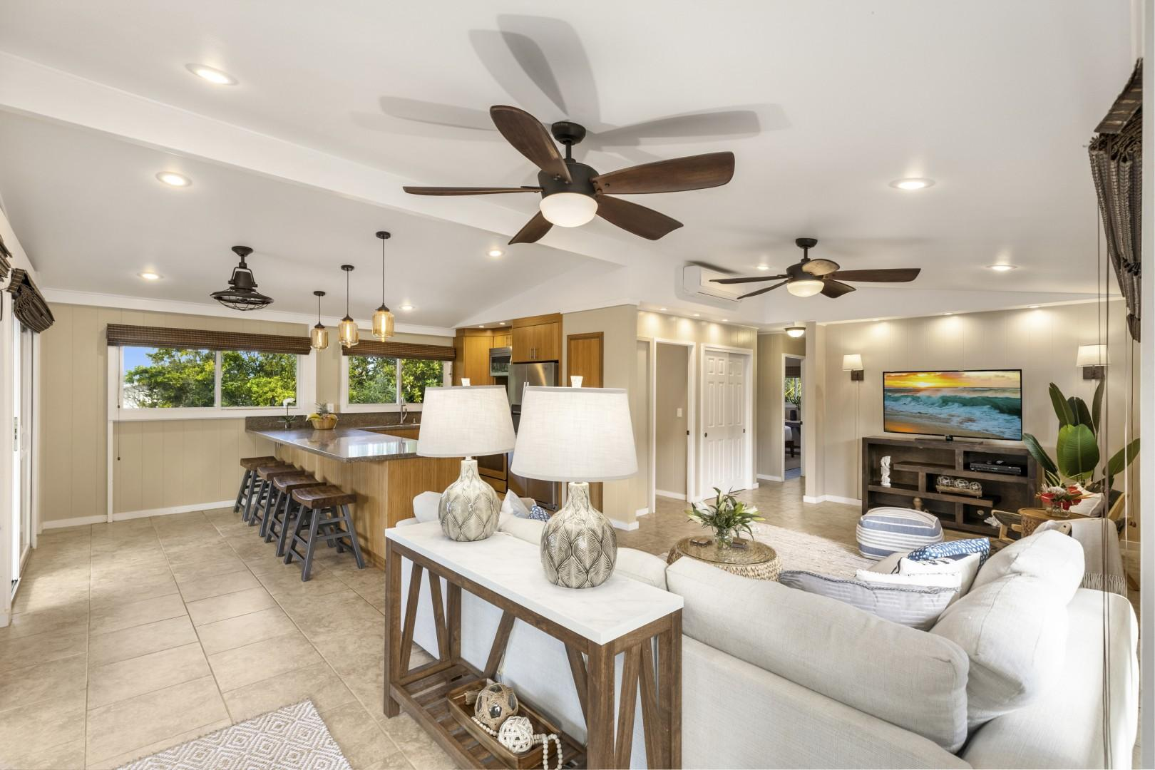 Upstairs great room; living room with large-screen tv and eat-in kitchen with stainless appliances and gas stove