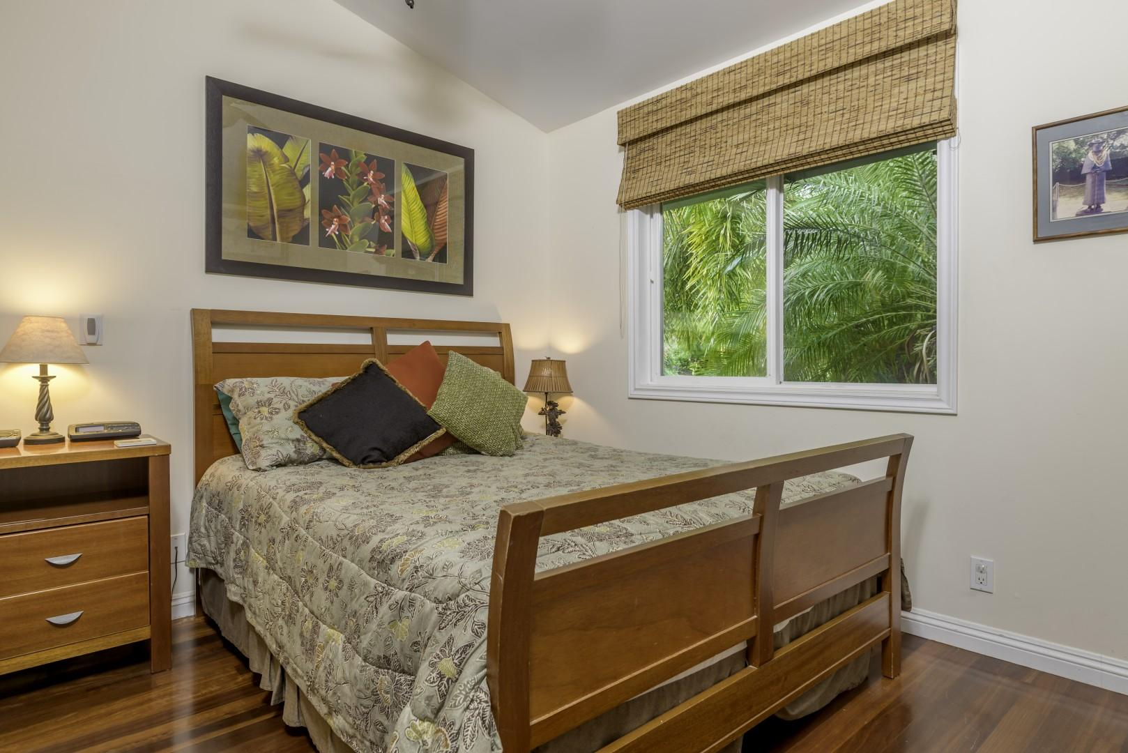 Master bedroom, with queen-size bed and split air conditioning system.