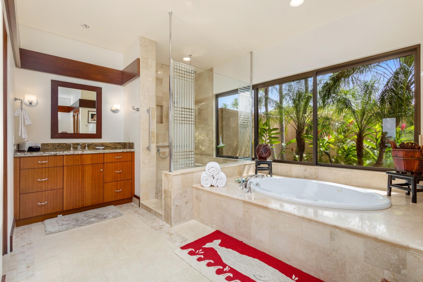 Master bathroom alternate view, featuring walk-in shower and views to lush tropical landscaping.
