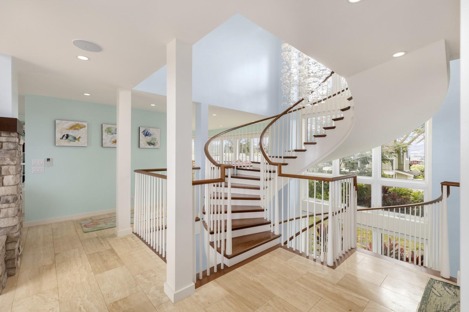 Custom spiral staircase, climbing all three floors.