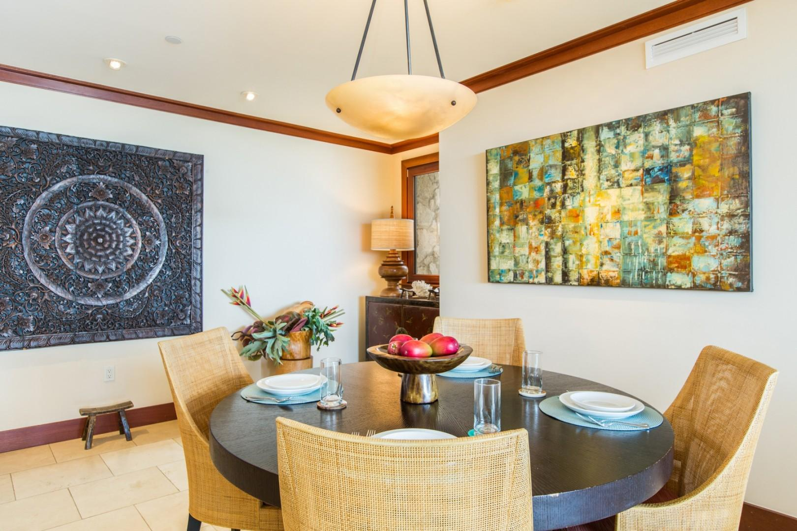 Dining area adjacent the open concept kitchen and living area is complimented with beautiful artwork and decor