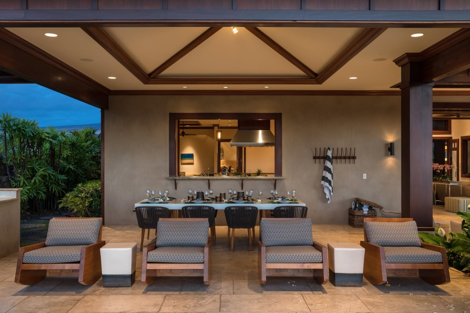 View of lanai rockers, outdoor dining area, and window to kitchen.