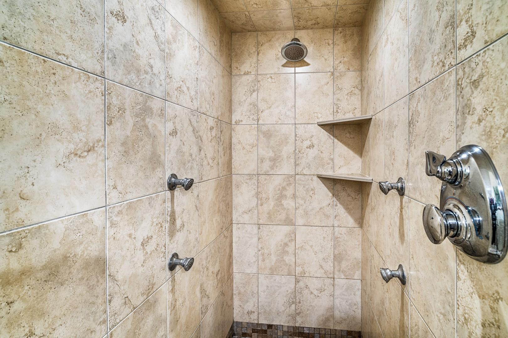 Master bathroom shower with multiple jets