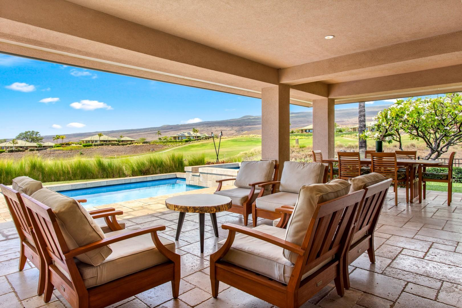 Closer view of lounge seating on the covered lanai with views of Mauna Kea, the regal mountain after which the resort is named.