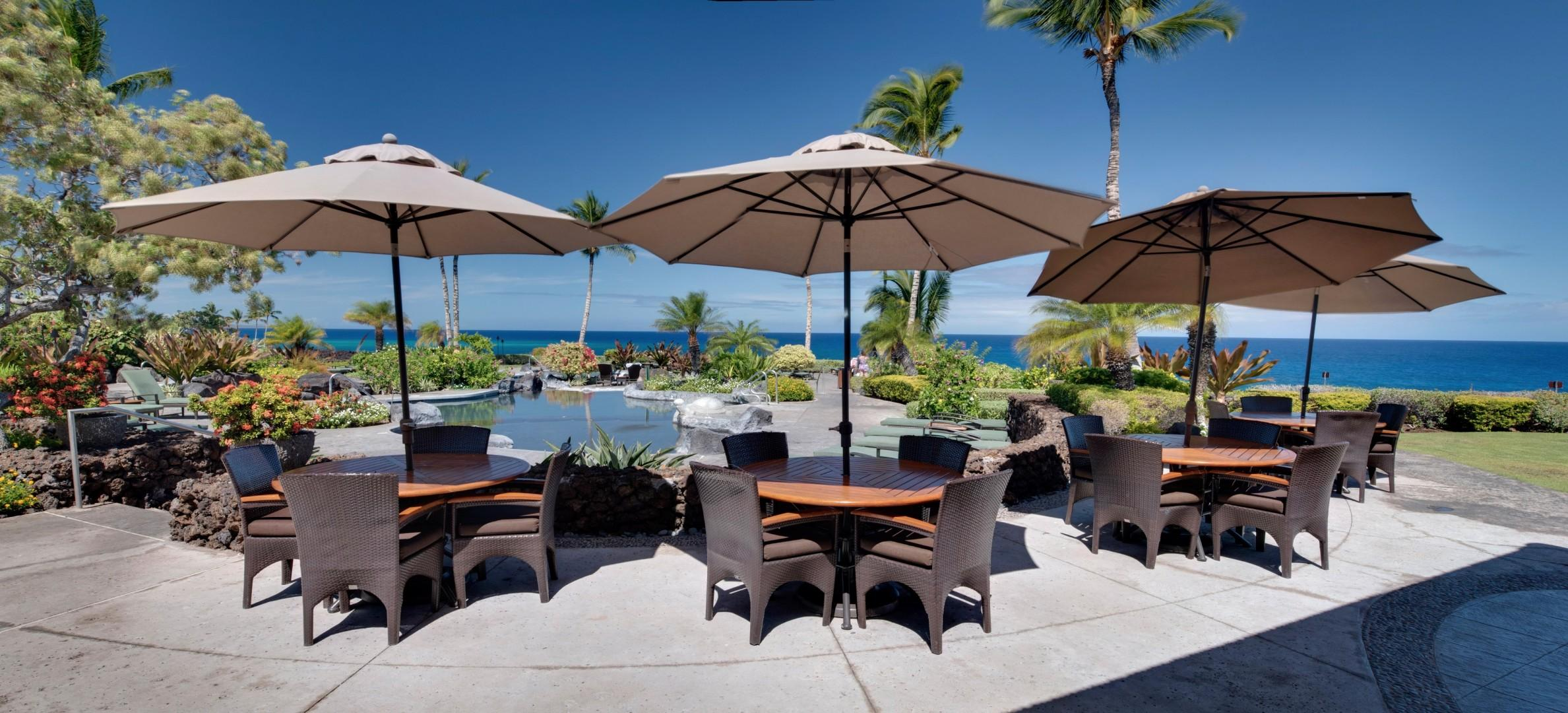Al fresco dining by the pool and ocean at Hali'i Kai Resort's private Ocean Club Bar & Grille
