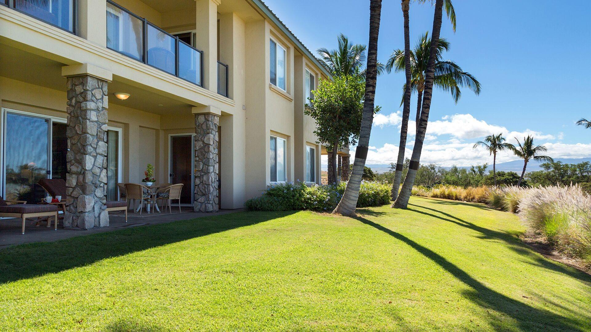A large grassy in front of your private lanai for your kids to enjoy playing or an area to sunbathe in the day or stargaze at night!