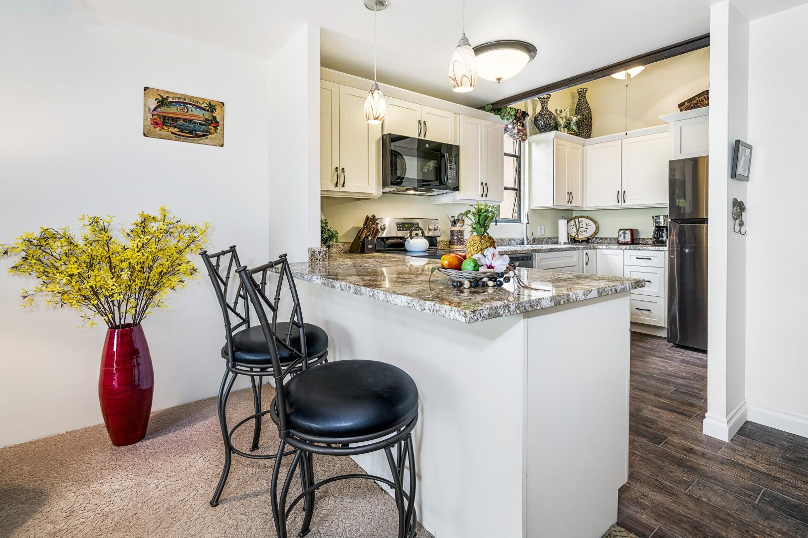 Eat-in kitchen with beautiful granite counter-tops!
