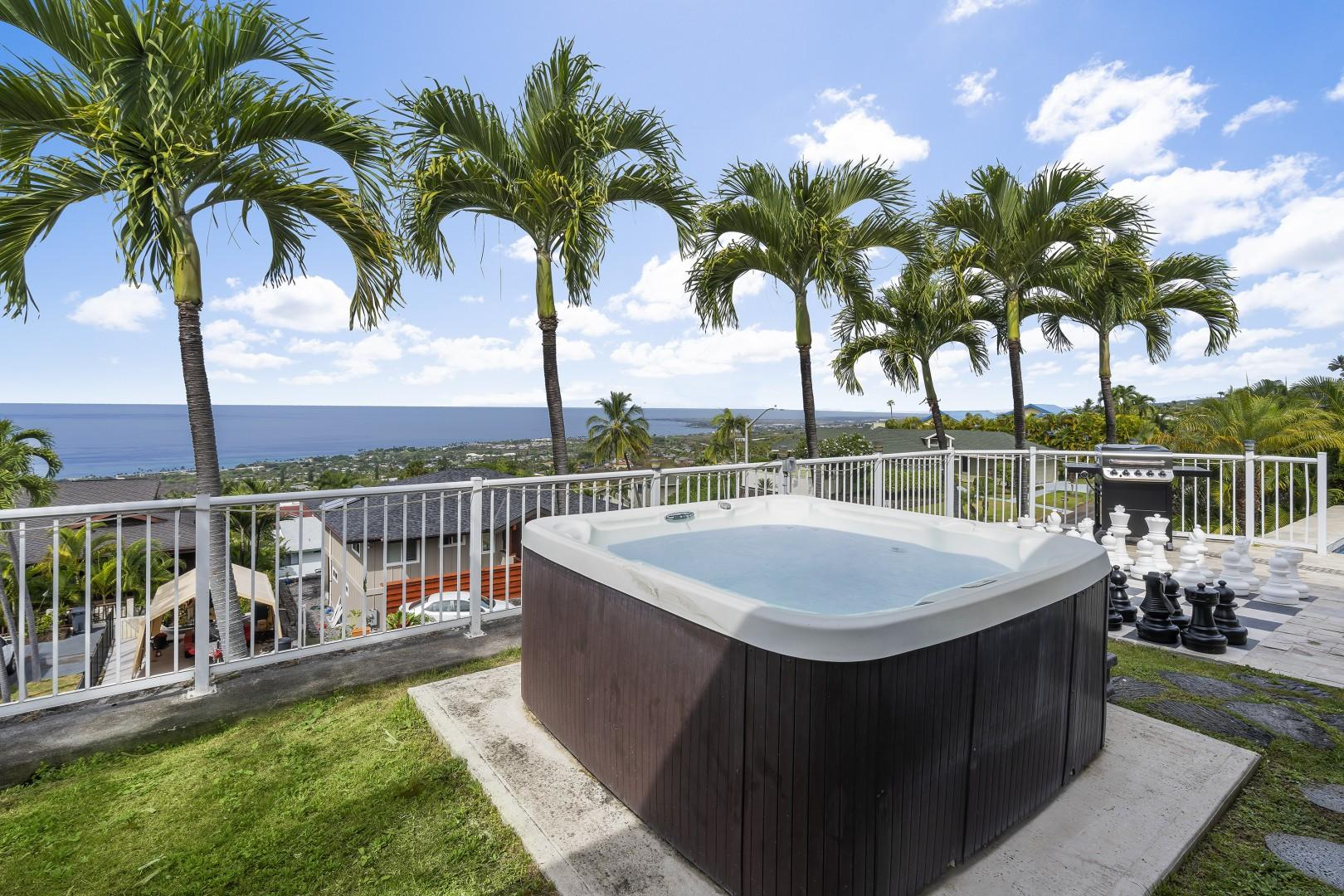 Enjoy the private hot tub with your favorite beverage!