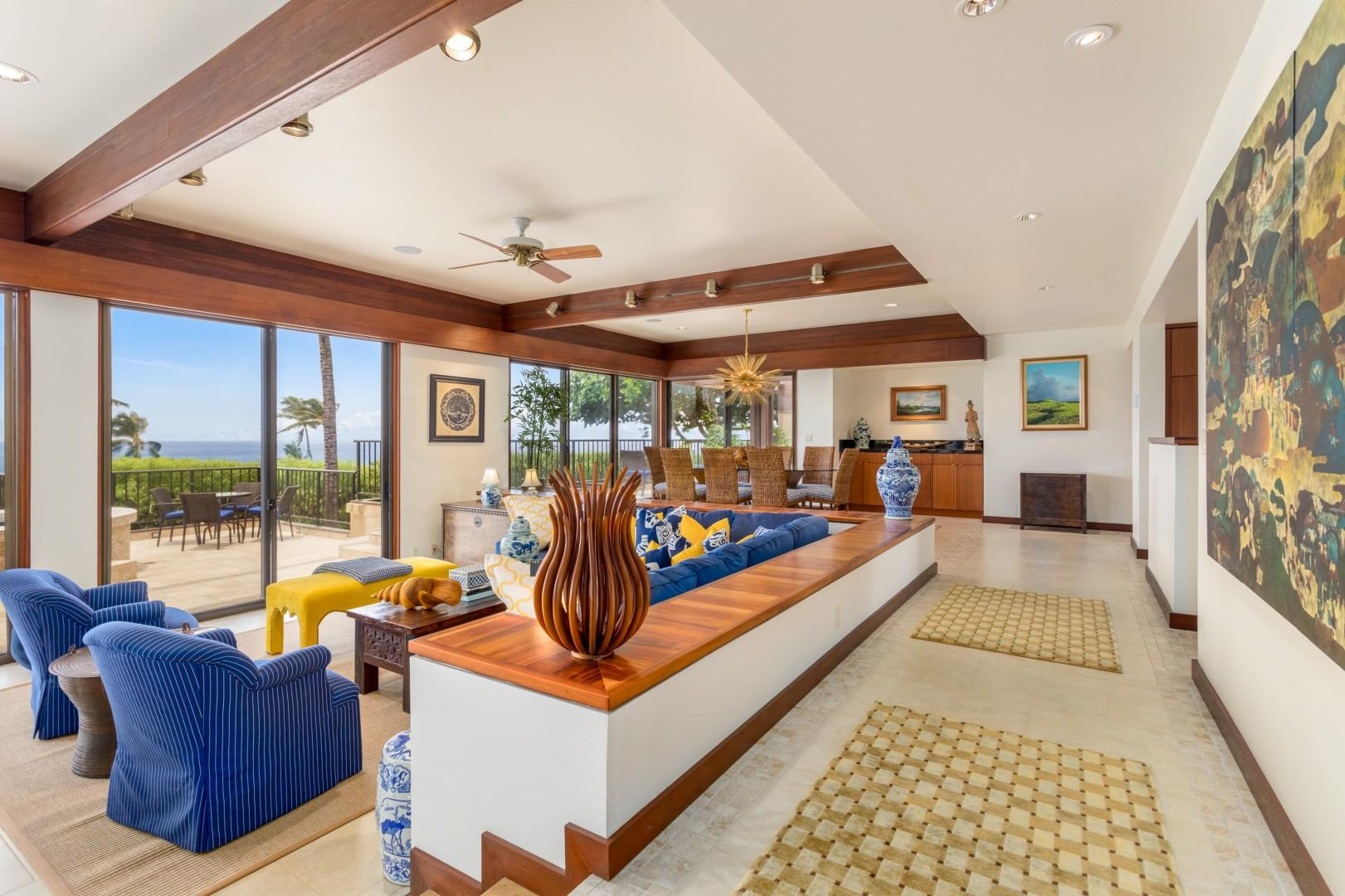 View of generous great room with recessed living area and ocean views.