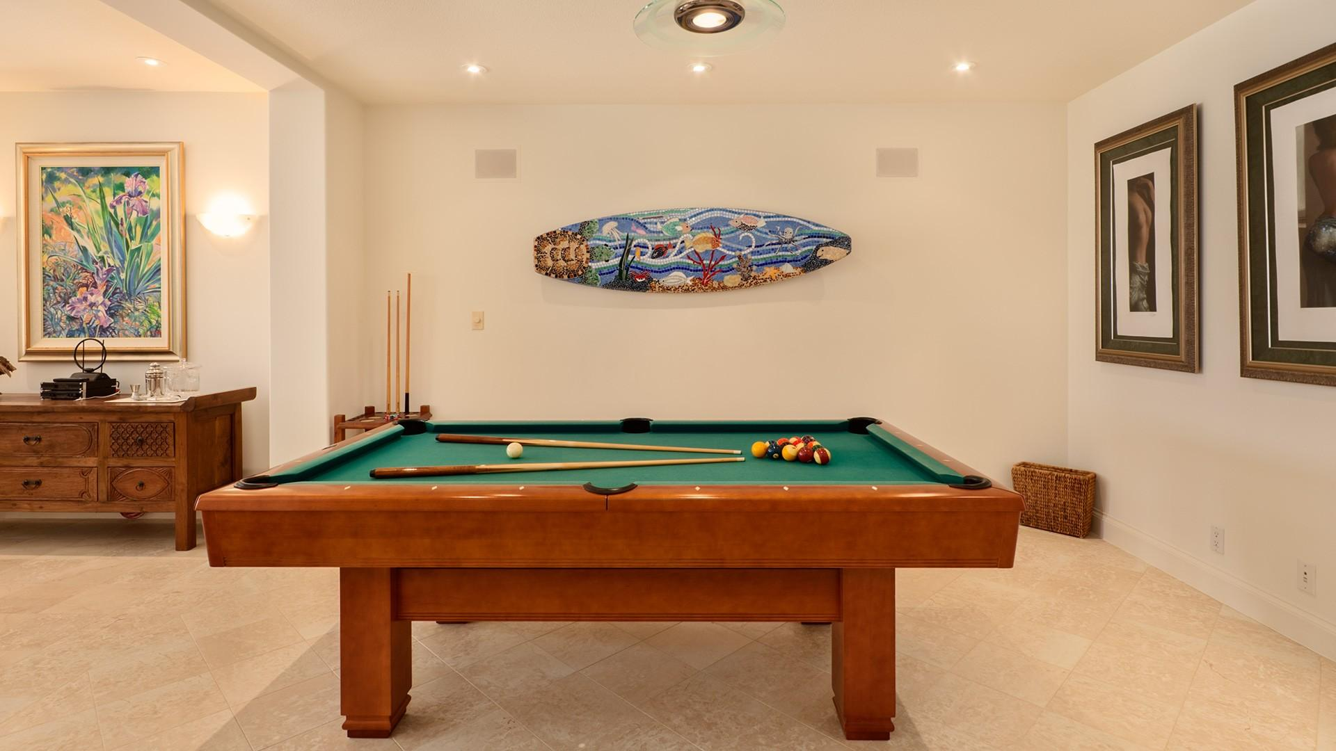 A pool table offers another opportunity for family fun.
