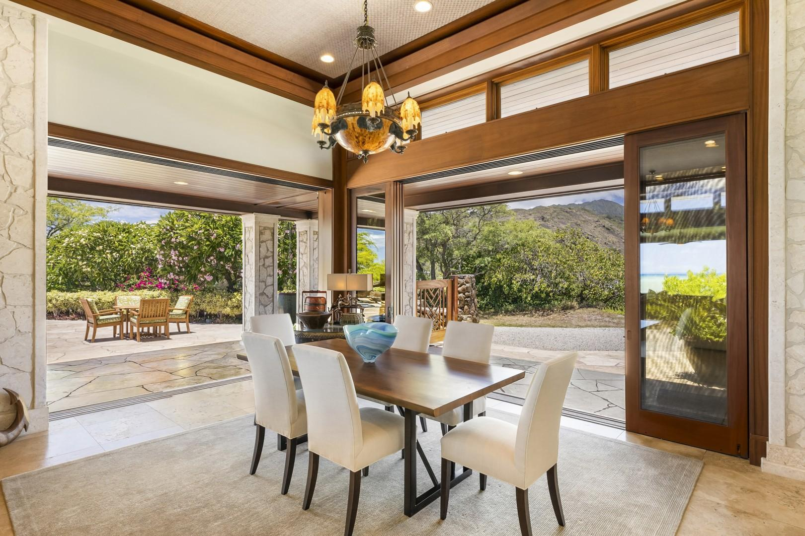 Dining Room opens to Poolside Lanai that has additional table seating.