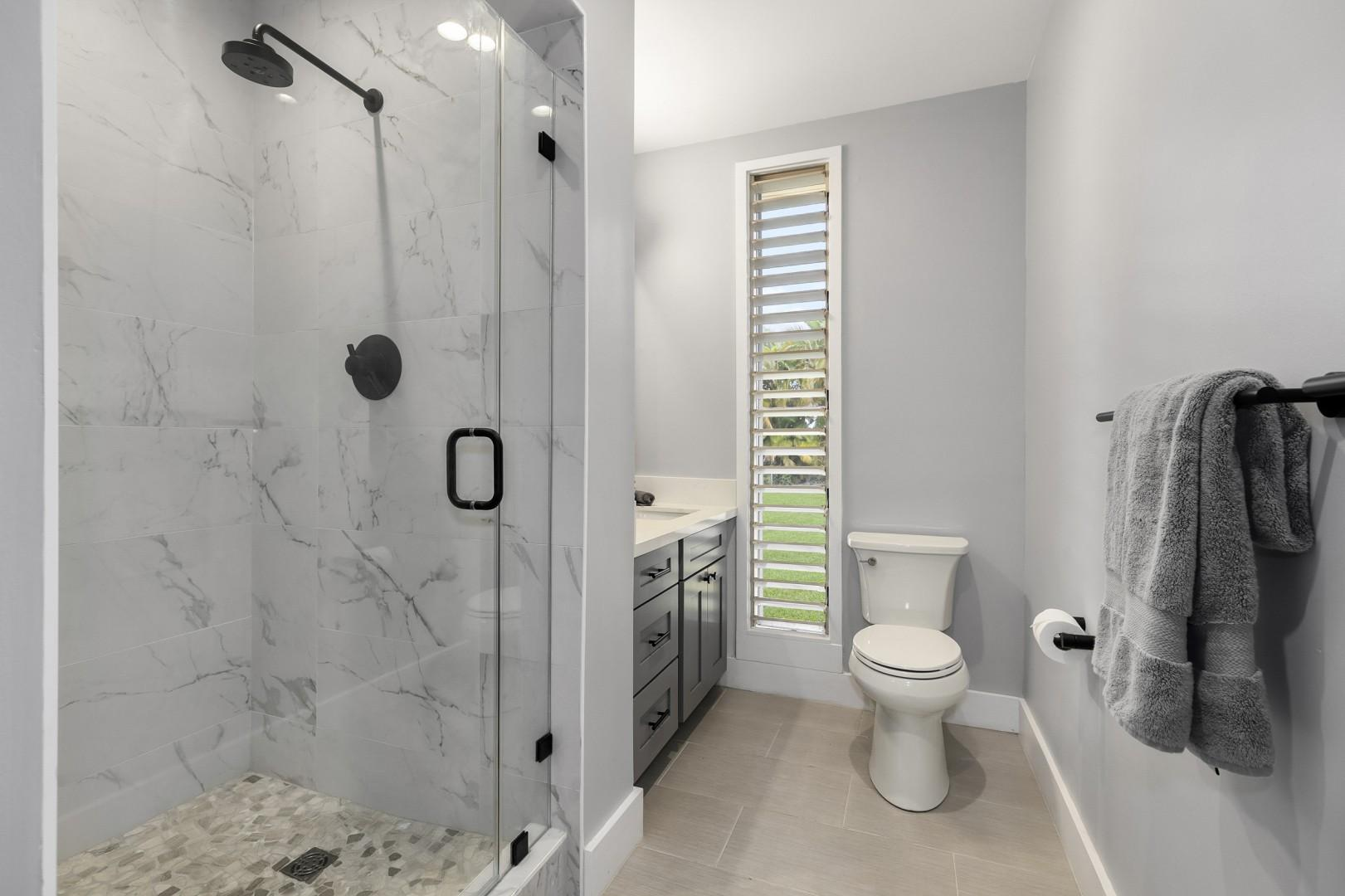 Full bathroom located in bedroom 2