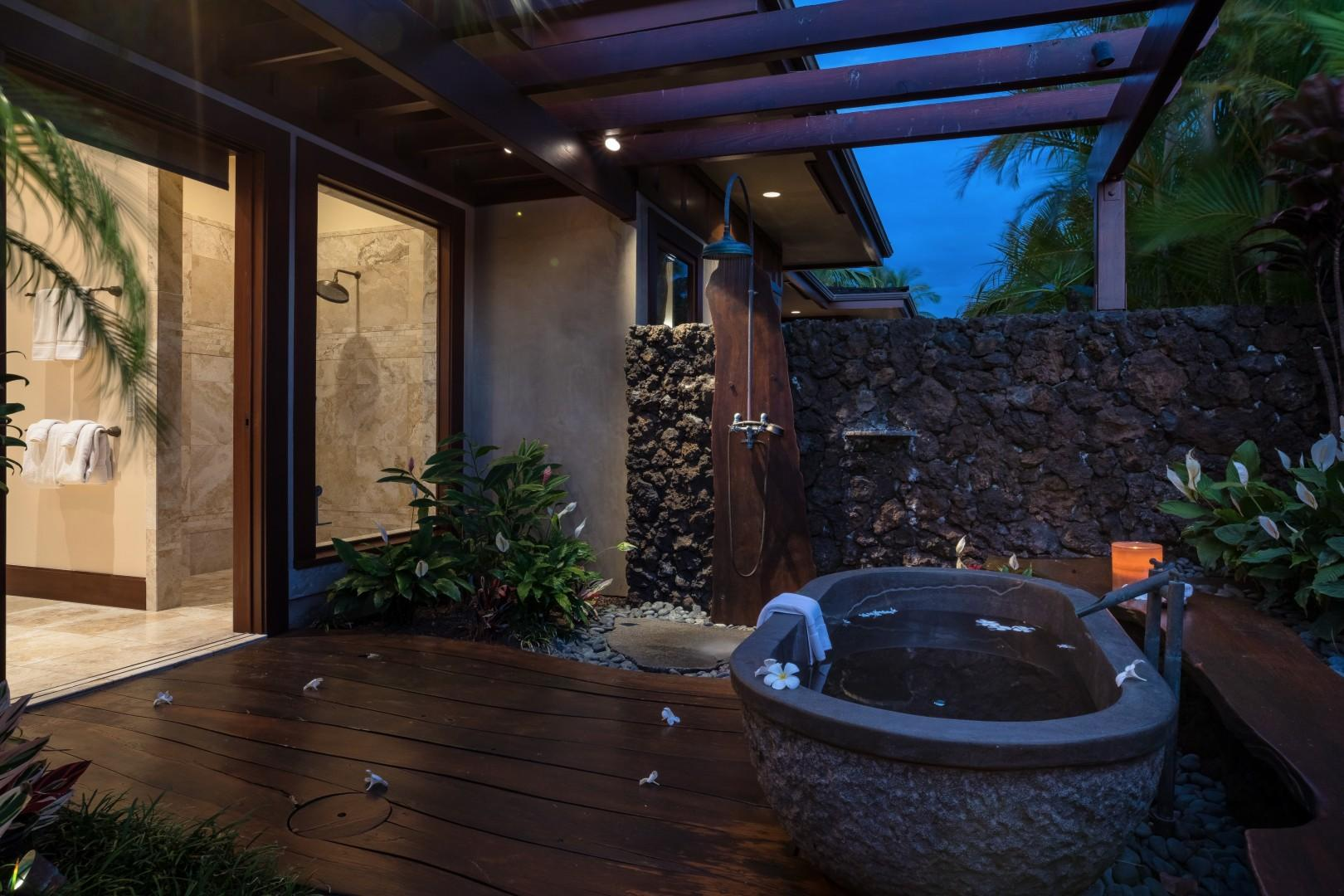 Outdoor soaking tub pictured in the evening. Soak in your own private paradise.