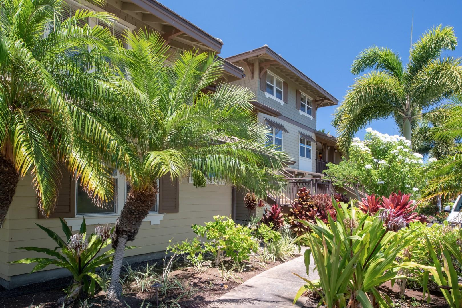 Lush tropical landscaping embellish the pathway to the villas