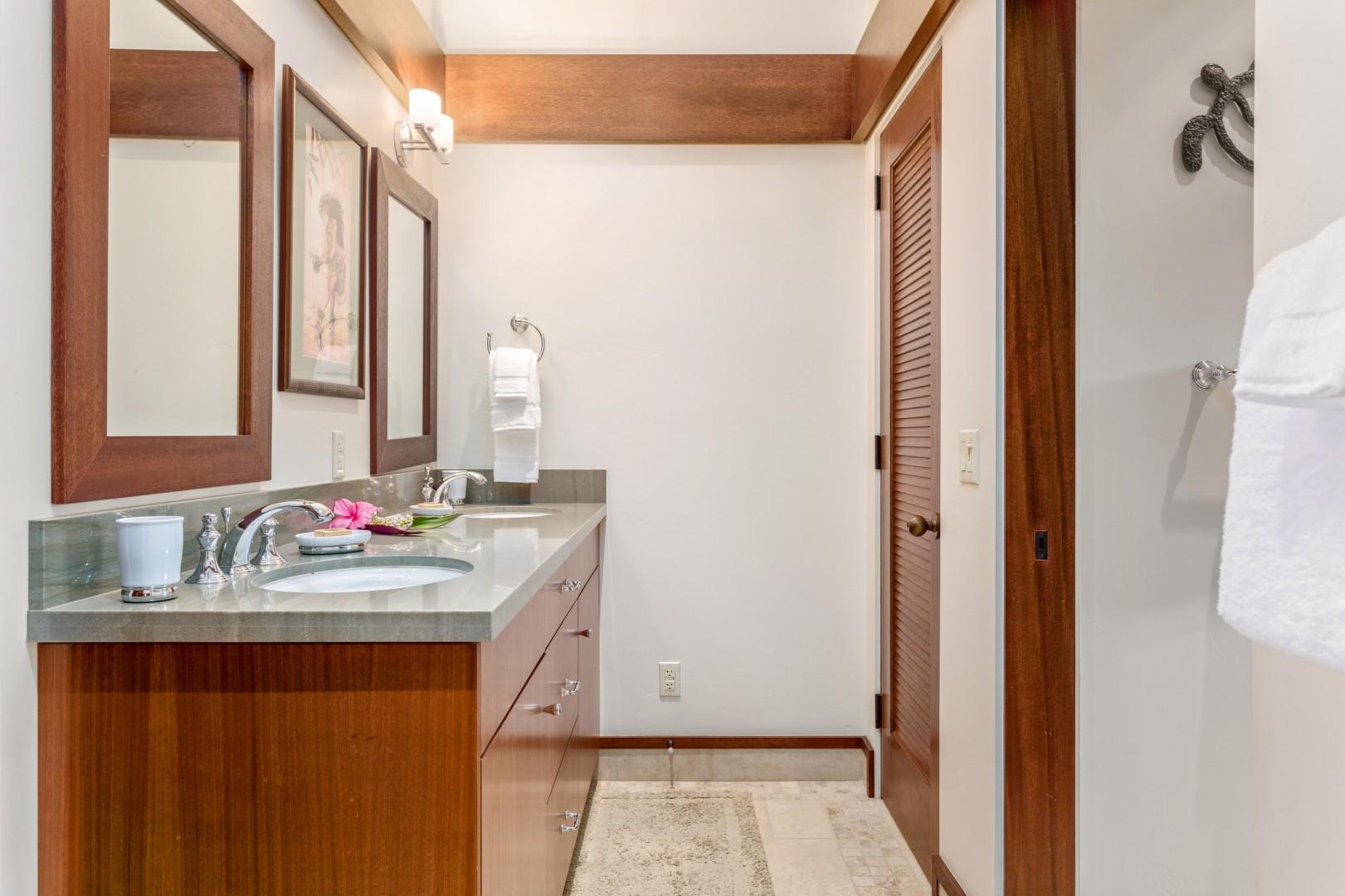 Large Jack-and-Jill-style bathroom with dual vanity, soaking tub, walk-in shower, and separate commode.