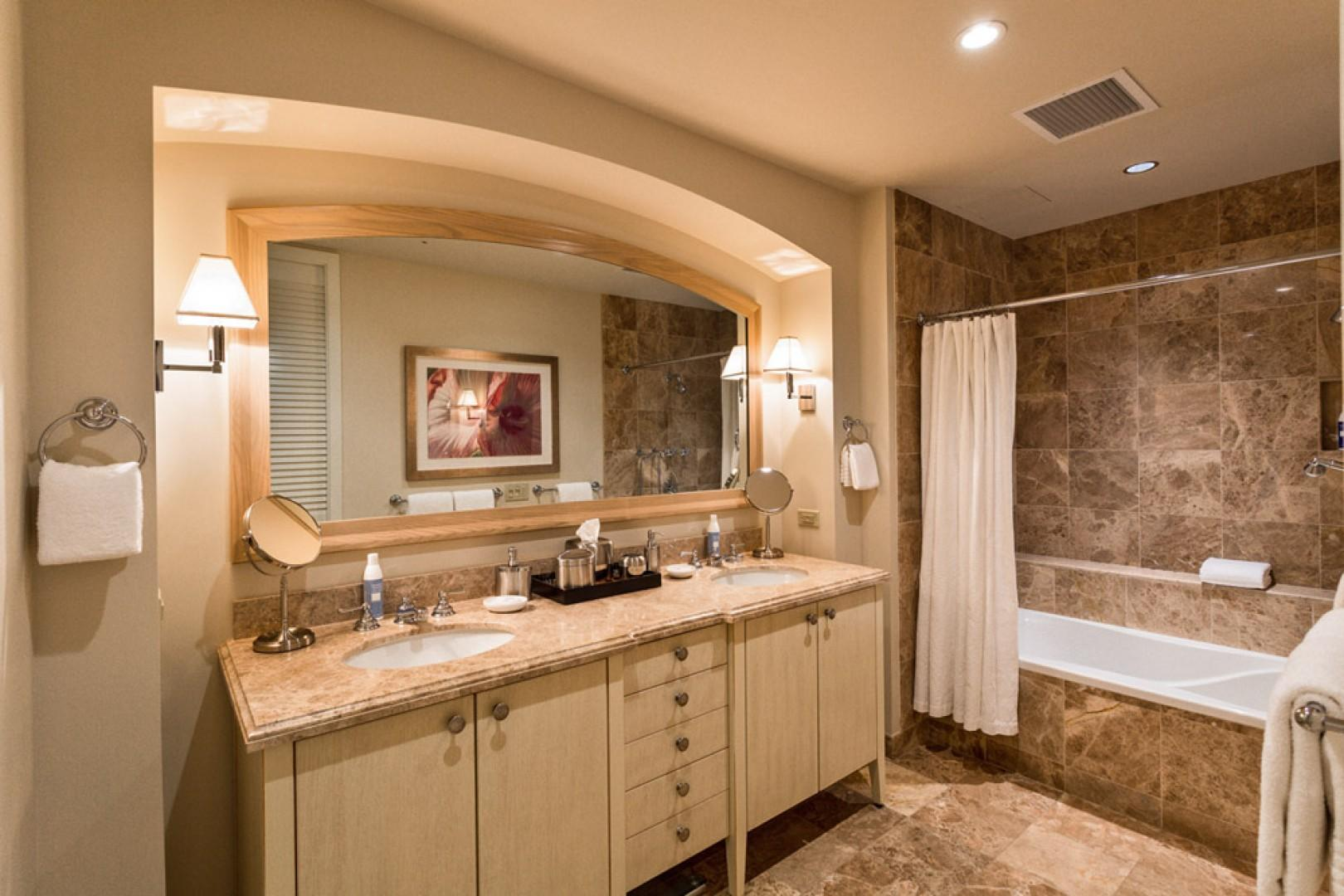 Second en suite marble bath with tub, shower, two vanities, and private water closet.