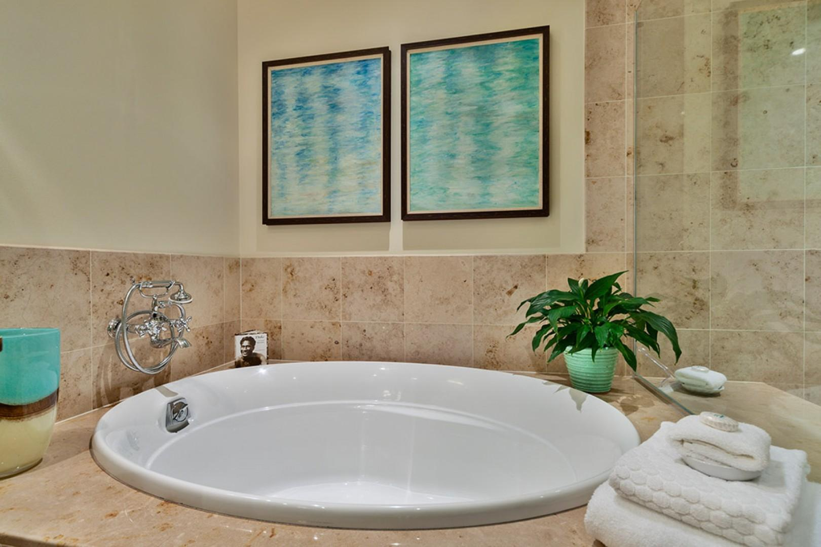 K507 Wailea Seashore Suite - Master Bedroom En-Suite Bathroom with Deep Soaking Tub, Glass Shower, Private WC, Dual Vanities, Walk-In Closet, Hair Dryers, Scale, Make Up Mirrors, Plush Cotton Bathrobes, Toiletries, Abundant Fluffy Towels, and more.