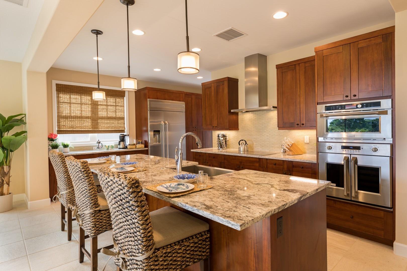 The open, modern kitchen features bar seating
