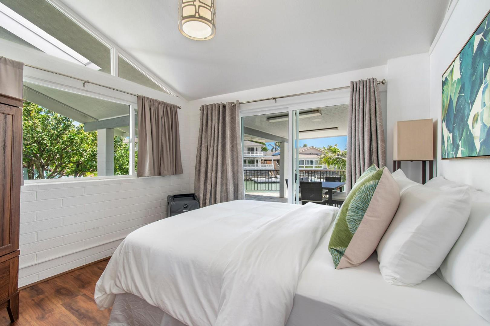 Bedroom 4 - Queen bed, standing ac with marina views.