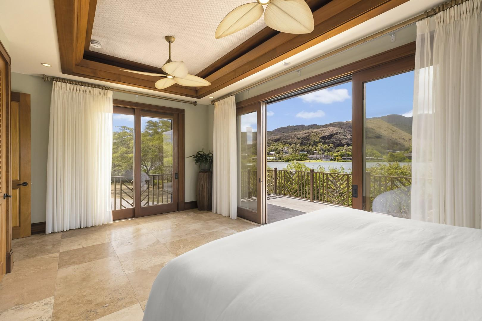 Upstairs Guest Bedroom with Large Lanai has Mountain and Lagoon Views