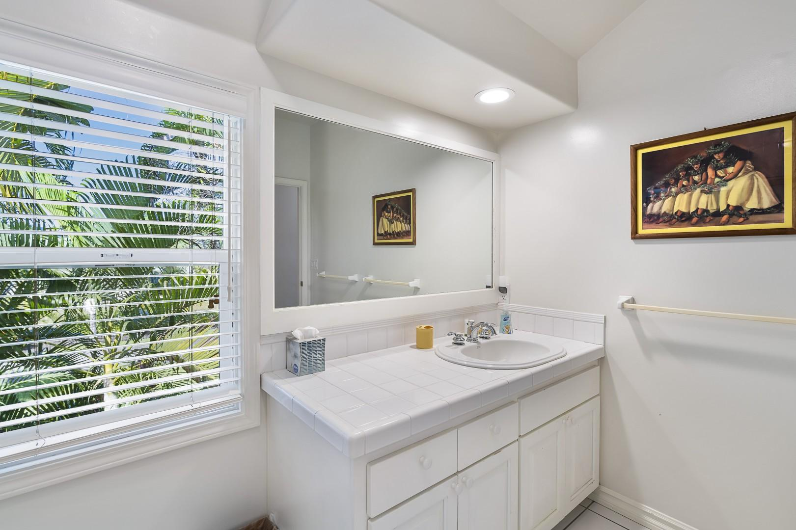 Share bathroom which features dual sinks