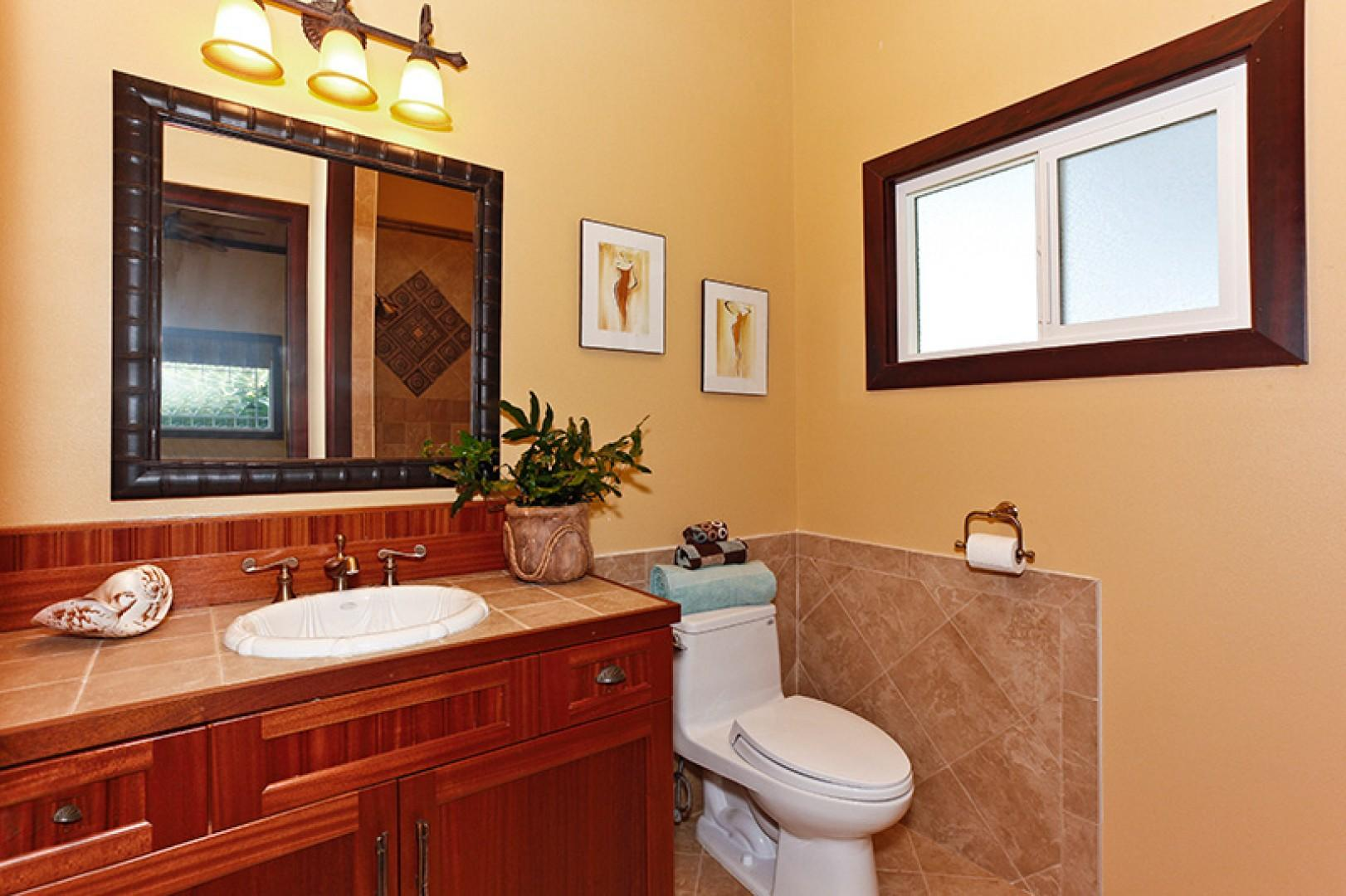 Shared guest bathroom for queen bedroom two and twin bedroom two.