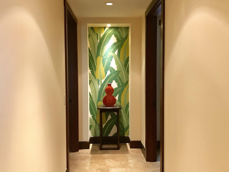 Downstairs hallway decorated with elegant artwork.
