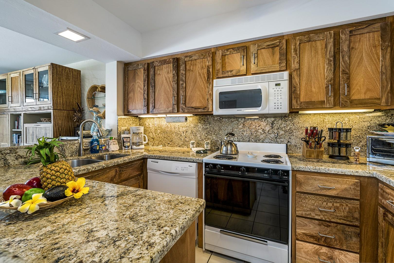 From Mango wood cabinets to granite counters in this kitchen!
