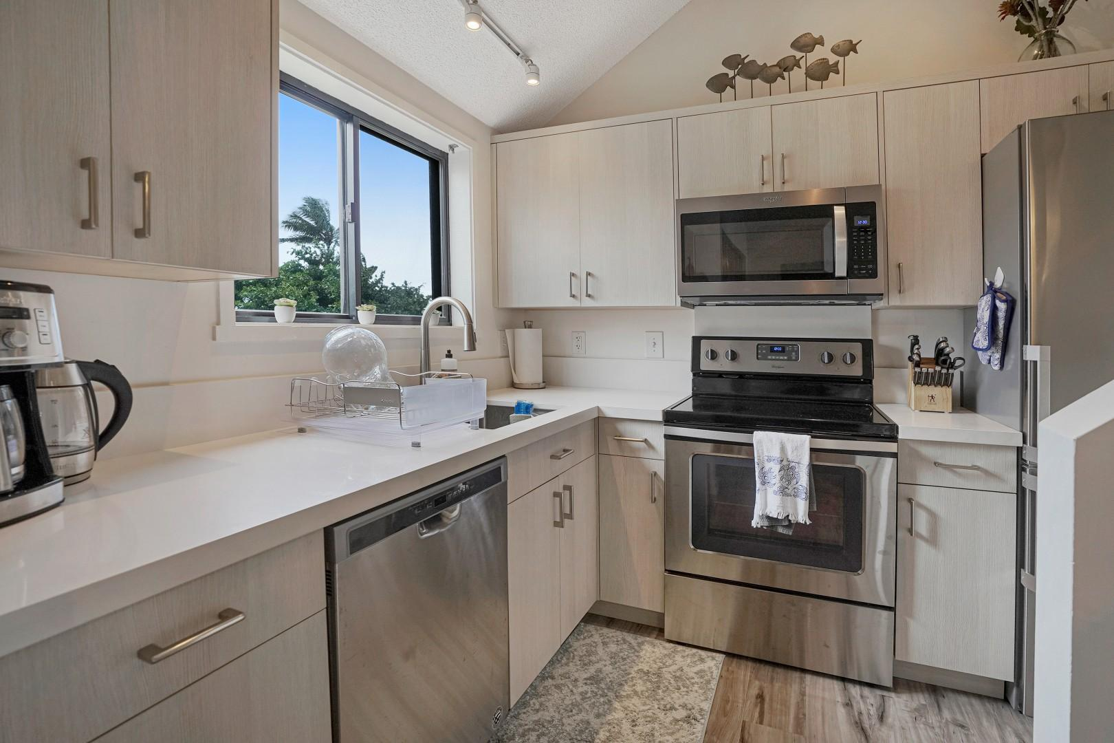 The updated kitchen has stainless steel appliances