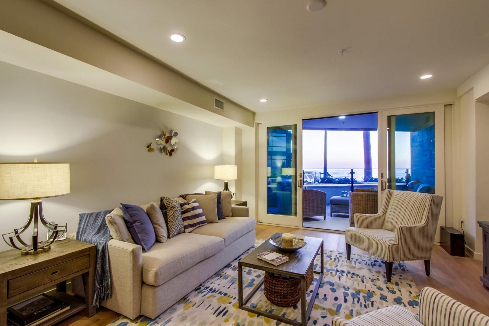 Tastefully furnished and comfortable living room with the terrace just beyond