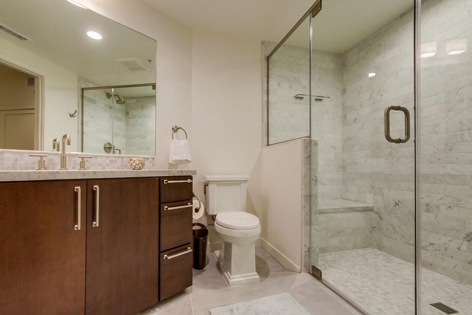Stone-topped vanity tiled walk in shower en-suite in Bedroom 3