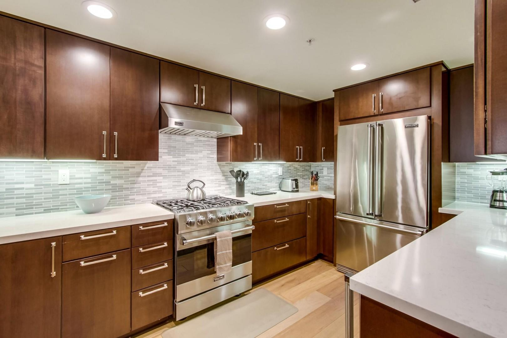 Beautifully appointed gourmet kitchen with Caesar stone counters