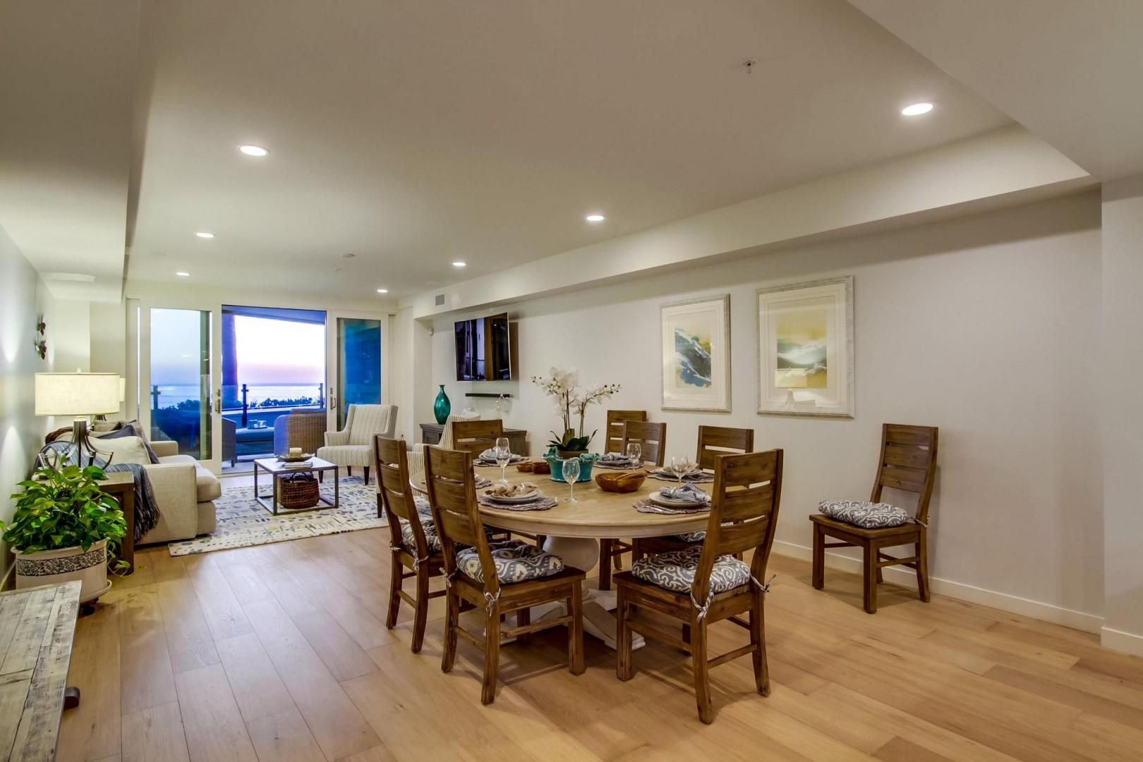 The dining table seats up to 8 and features ocean views