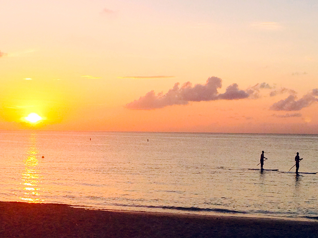 Paddle board the Caribbean at dusk.
