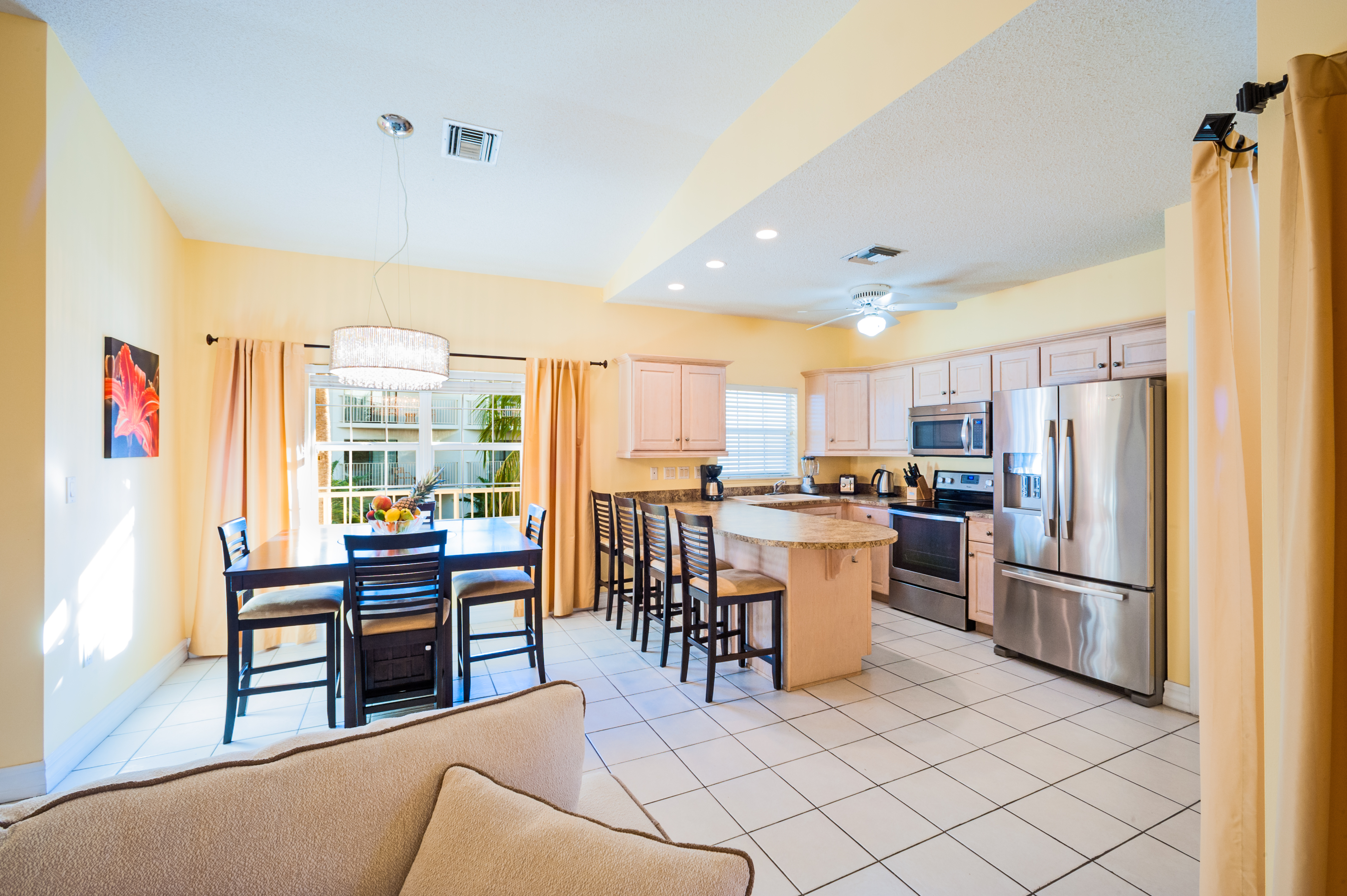 Fully Stocked Kitchen with dining area.